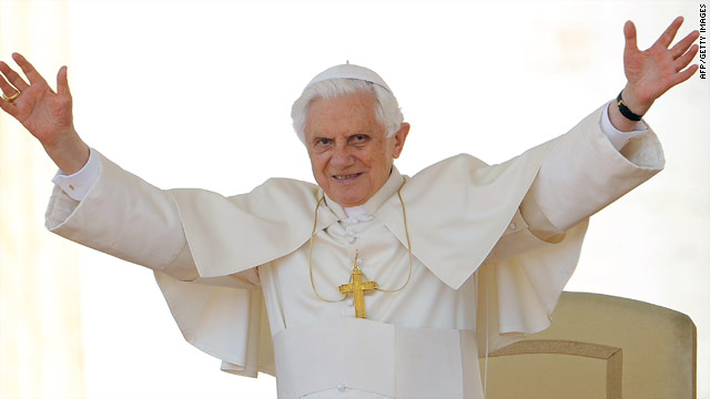 Pope Benedict XVI waves as he arrives in St.Peter's Square for his weekly general audience on Wednesday.