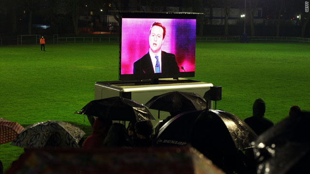 Students in Brimingham brave the rain to watch the third UK election debate between leaders of the main political parties.