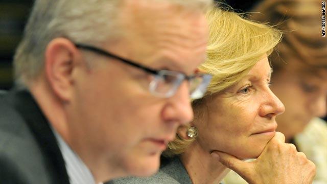 Olli Rehn of the EU, left, and Spanish Finance Minister Elena Salgado speak to reporters early Monday.