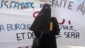 A woman in Tours, France, in February protests the movement in France to ban the full Islamic veil.