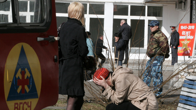 Relatives sit near the Raspadskaya mine in the Kemerovo region of southwestern Siberia on Sunday.