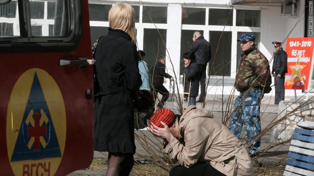 Relatives sit near the Raspadskaya mine in the Kemerovo region of southwestern Siberia on Sunday.