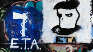 Graffiti displays the logo of Basque separatist armed group ETA in the northern Spanish Basque village of Oquendo.