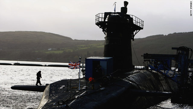 A Royal Navy nuclear-armed submarine sits in the dock at its Scottish base in 2006.