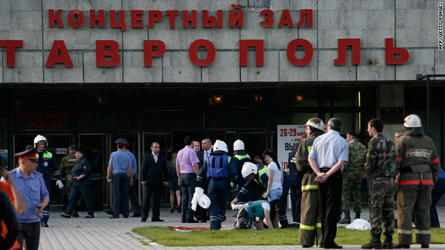 Police and ambulance officers help people injured during Wednesday's explosion at the Stavropol concert hall on May 26, 2010.
