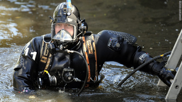 A police diver searches the river in West Yorkshire, northern England, on May 28.