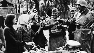 Lithuanians welcome Nazi soldiers with flowers in the summer of 1941.