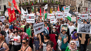 Demonstrators walk through central London during a protest against Israel on June 5, 2010.