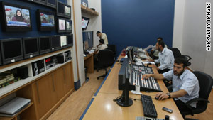 Palestinians work at Hamas-run Al-Aqsa TV in Gaza City on June 15 after Paris decided to take it off the air in France.