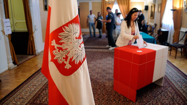 A woman casts her ballot in a polling station in Madrid during Poland's presidential elections.