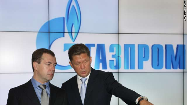 Russian President Dmitry Medvedev, left, and Gazprom CEO Alexei Miller examine a Gazprom exhibition stand in St. Petersburg on Saturday.
