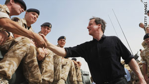 British Prime Minister David Cameron meets troops in Afghanistan on June 11.