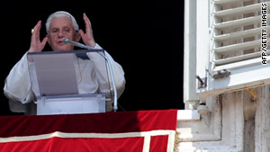 Pope Benedict XVI adresses the crowd during his Sunday Angelus prayer at the Vatican.
