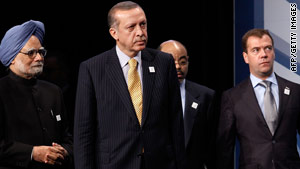 Turkish Prime Minister Recep Tayyip Erdogan, center, is pictured at the G-20 summit in Toronto on Sunday.