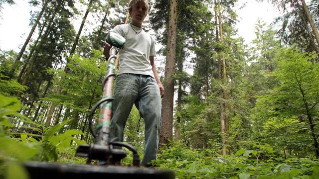 Treasure hunter Walter Fritz searches for the buried cash in the Schranzerwald forest near Ebbs, Austria.