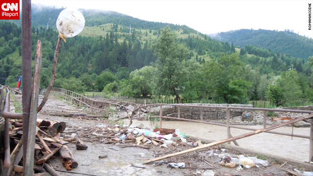 A photo from an iReporter shows the river rising after rain in Brusturoasa, Romania.