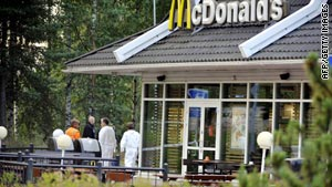 Investigators look for evidence outside a McDonald's in Porvoo, Finland, on Tuesday.