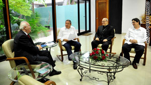 Cuban officials meet with Spain's foreign minister on Wednesday in Havana.