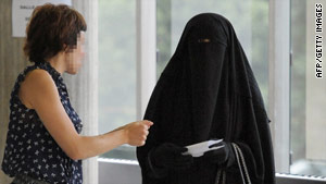 A veiled woman speaks with another woman at a courthouse in Nanterre, Paris, earlier this month.