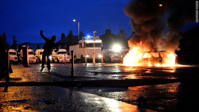 Cars burn during Nationalist rioting in the Ardoyne area of Belfast on July 12, 2010. Rioting continued Tuesday night.