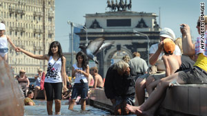 Muscovites attempt to keep cool in a fountain in central Moscow on July 15, 2010.