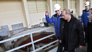 Prime Minister Vladimir Putin tours a hydroelectric plant with RusHydro officials earlier this year.