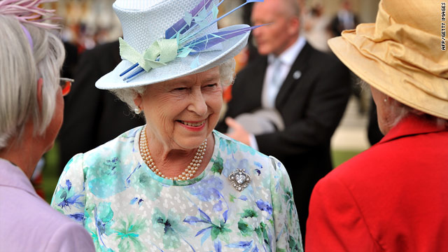 On July 20, Queen Elizabeth talks to guests at Buckingham Palace -- she later withdrew a party invitation to Nick Griffin.