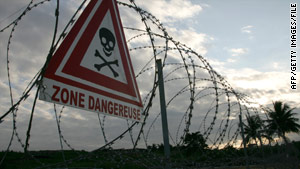 Barbed wire restricts access to the toxic dumping zone in the Ivory Coast in 2007.