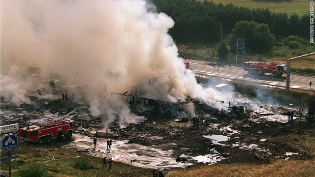 Smoke rises from the site of a Concorde jet crash near Paris on July 25, 2000.