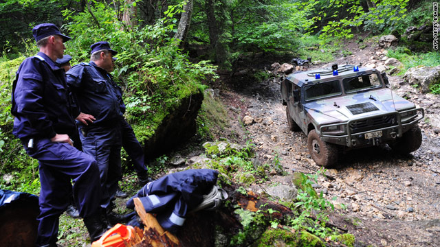 Romanian gendarmes secure the area on the Bucegi mountains on July 27, 2010 where a Israeli helicopter crashed  on the 26th.