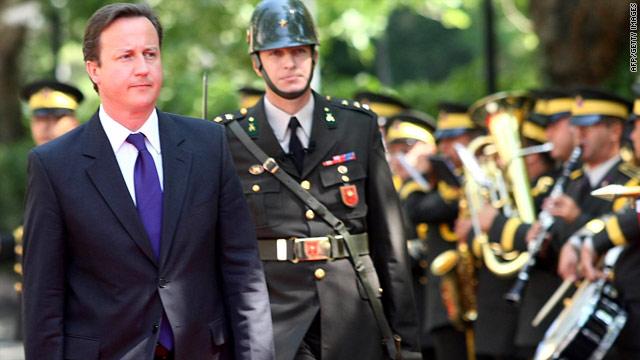 British PM David Cameron inspects a Turkish honor guard in Ankara on July 27, 2010.