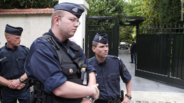 French police guard the entrance of Liliane Bettencourt's home on July 26.
