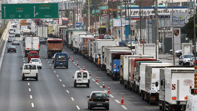 Fuel-tanker drivers block the right lane of traffic on a highway near Athens, Greece. during a protest on July 26.