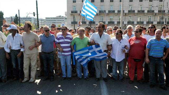 Truck drivers holding Greek flags march to the Greek Parliament on Friday in Athens. They said they would maintain a strike that has caused severe fuel shortages across the country.