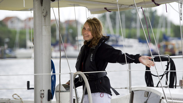 Laura Dekker, 14, waves goodbye as she leaves the harbor in Den Osse on August 4, 2010.