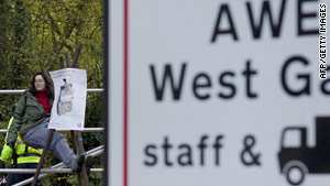 A lone protester sits outside the Atomic Weapons Establishment at Aldermaston, England.