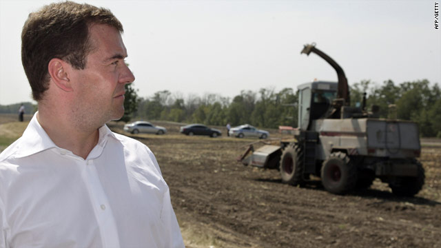 Russian President Dmitry Medvedev walks through a field while touring a farm on August 12, 2010.