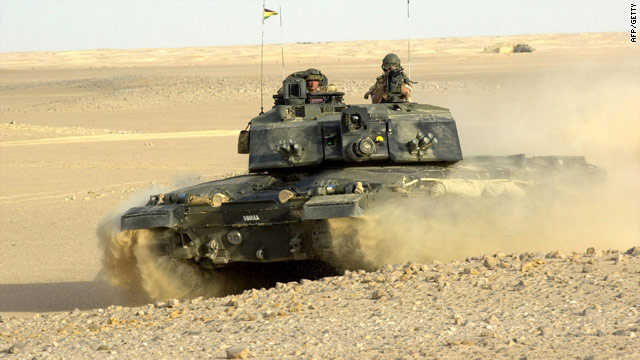 A British Challenger 2 tank takes part in an exercise in Oman: The British Ministry of Defense has been warned to expect cuts.