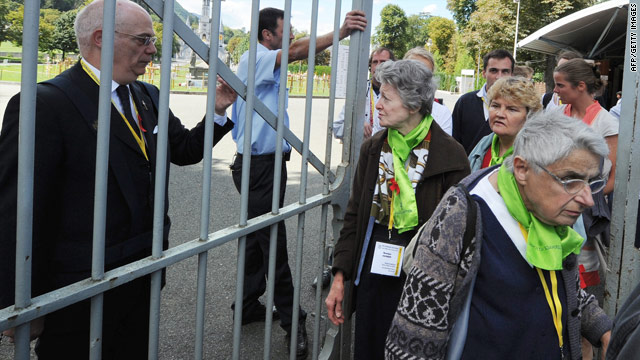 Pilgrims are evacuated from Lourdes, France, after a bomb scare during the Assumption festivities on Sunday.