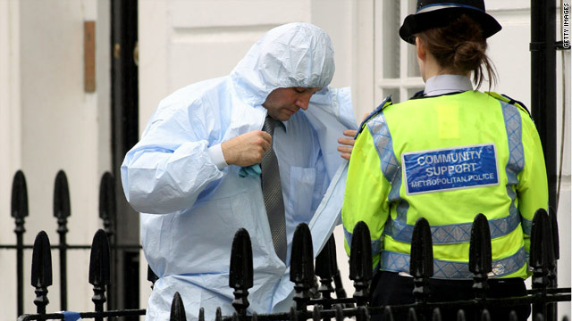 A police forensics officer leaves a central London home where the body of a missing man was discovered on August 25, 2010.