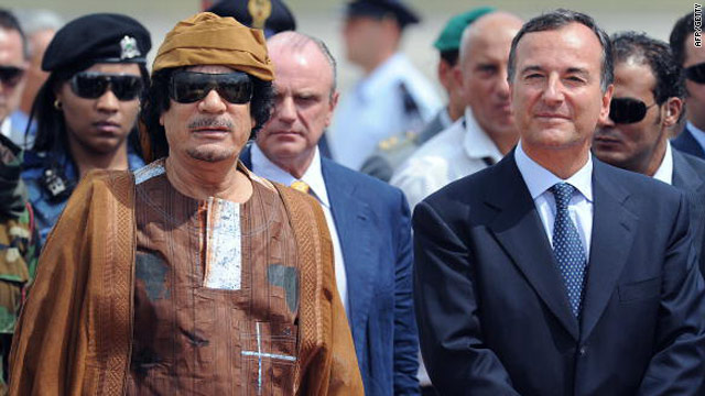 Libya's leader Moammar Gadhafi (left) next to Italy's foreign minister Franco Frattini August 29 at Ciampino airport, Italy.