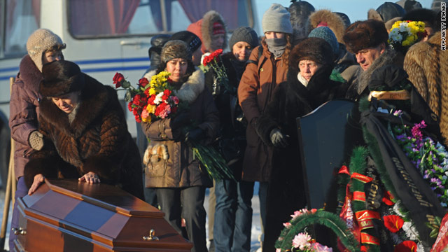 Relatives mourn the victim of a Russian nightclub fire during funeral ceremonies outside Perm, December 7, 2009.