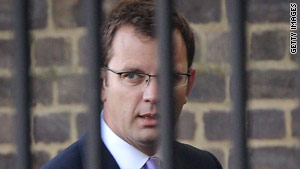 Andy Coulson resigned as editor of the News of the World after a reporter was jailed for hacking into phone messages.