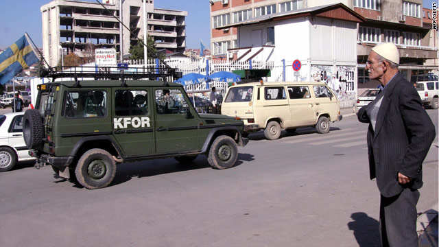 A jeep patrols Pristina, the capital of Kosovo, as part of a NATO-led force. Talks between Kosovo and Serbia now look likely.