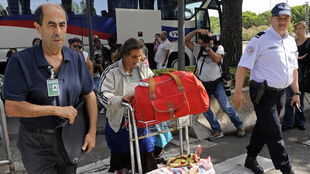 Roma families arrive at Marseille Provence airport on September 14 before boarding a flight to the Romanian capital Bucharest.