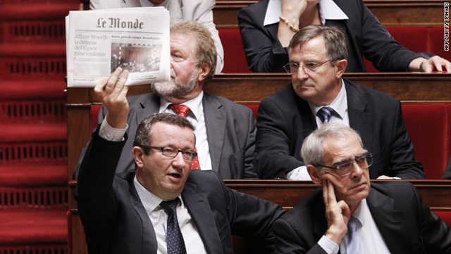 French socialist deputy Christian Paul holds Le Monde newspaper Tuesday at the French National Assembly in Paris.