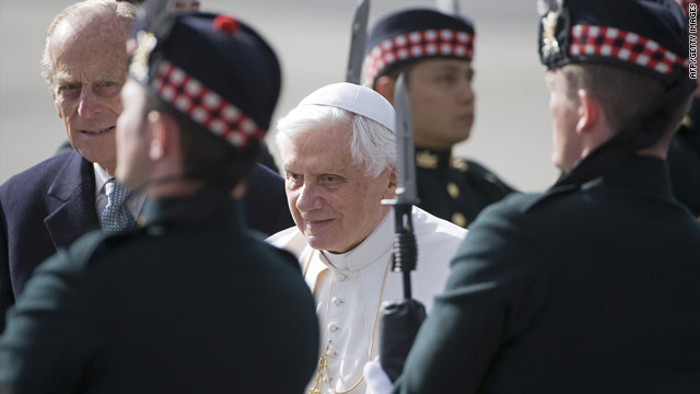 Pope Benedict XVI inspects a guard of honour accompanied by Britain's Prince Philip at Edinburgh airport, September 16, 2010.