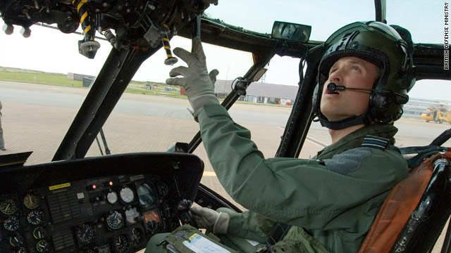 Prince William sits in a helicopter cockpit in an image released by the British Ministry of Defense.