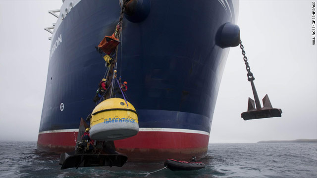 "Greenpeace campaigners have attached a ""survival pod"" to the Stena Carron's anchor chain, September 22, 2010."