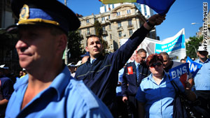 Romanian trade union members shout anti-government slogans in Bucharest.